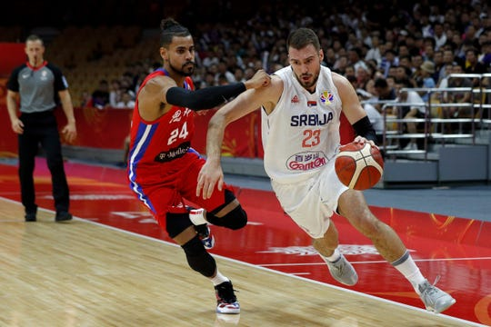 Marko Guduric of Serbia is challenged by Gian Clavell of Puerto Rico during their World Cup game Sept. 6.