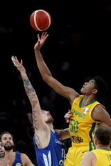 Czech Republic's Ondrej Balvin (left) fights for the ball against Brazil's Bruno Caboclo during Saturday's game.