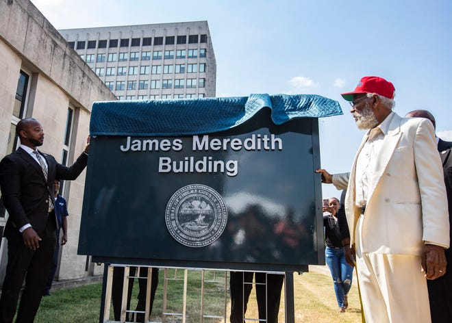 James Meredith unveils the James Meredith Building sign during the renaming ceremony of the 157 Poplar  Avenue, the Shelby County Election Commission building in downtown Memphis, Tenn., on Monday, Sept. 9, 2019.