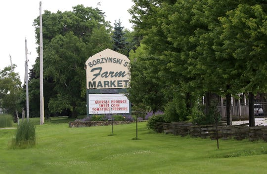 Borzynski's Farm Market in Mount Pleasant sells produce grown in Wisconsin, including cabbage, sweet corn, leafy greens and green beans. A federal indictment alleges 14 men from Mexico were forced to work illegally in nearby fields owned by the Borzynskis in 2016. The owners of the farm said in a statement that they had no knowledge of the alleged trafficking.