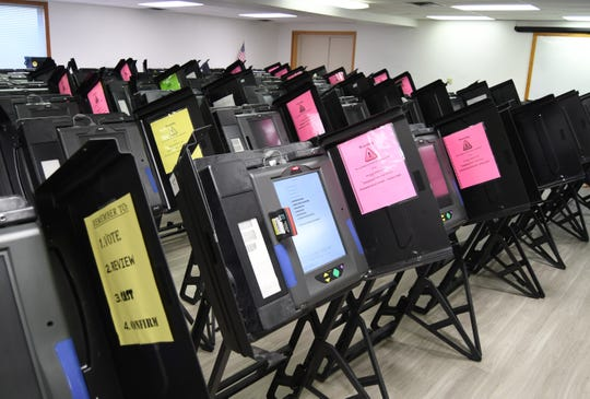 Rows of voting machines stand ready to be tested Monday morning at the Baxter County Election Commission's office.