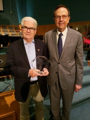 State Representative Jack Fortner (left) receives a Statesman Award from Jerry Cox, President of the Family Council Action Committee, on Sunday at Twin Lakes Baptist Church.