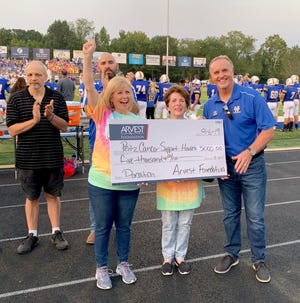 Arvest representatives presented a surprise donation of $5,000 to the Peitz Cancer Support House.