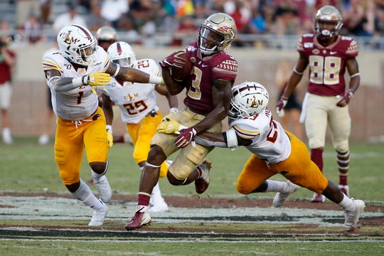Sep 7, 2019; Tallahassee, FL, USA; Florida State  running back Cam Akers (3) picks up a first down against ULM at Doak Campbell Stadium.