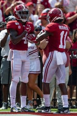 Alabama wide receiver Jerry Jeudy (4) and wide receiver Henry Ruggs, III, (11) celebrate Jeudy's early touchdown against New Mexico State at Bryant-Denny Stadium in Tuscaloosa, Ala., on Saturday September 7, 2019.