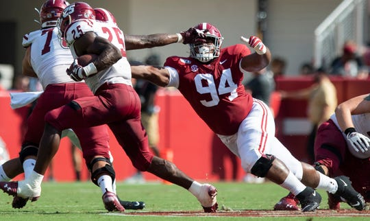Alabama defensive lineman DJ Dale (94) reaches for New Mexico State running back Christian Gibson (25) at Bryant-Denny Stadium in Tuscaloosa, Ala., on Saturday September 7, 2019.