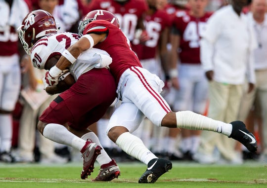 Alabama defensive back Scooby Carter (11) stops New Mexico State running back Naveon Mitchell (20) at Bryant-Denny Stadium in Tuscaloosa, Ala., on Saturday September 7, 2019.