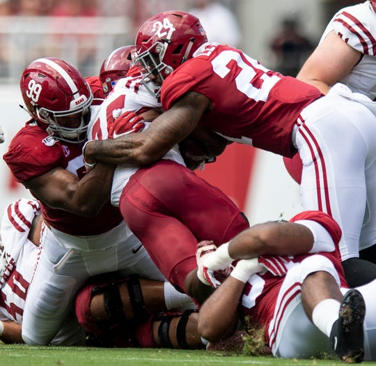 Alabama defensive lineman Raekwon Davis (99) and linebacker Terrell Lewis (24) stop n25o\ at Bryant-Denny Stadium in Tuscaloosa, Ala., on Saturday September 7, 2019.