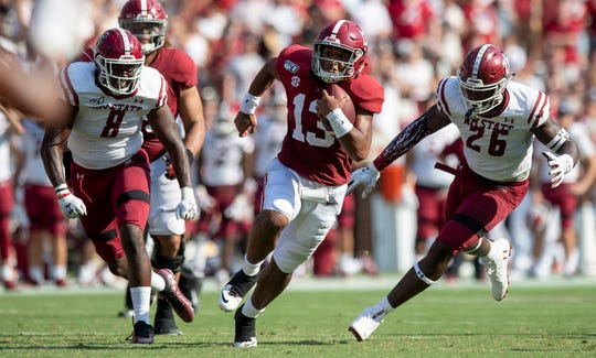 Alabama quarterback Tua Tagovailoa (13) carries for a touchdown against New Mexico State at Bryant-Denny Stadium in Tuscaloosa, Ala., on Saturday September 7, 2019.