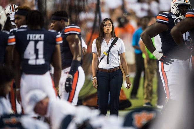 Lauren Silvio, Auburn's director of sports nutrition, walks the sideline during a game against Tulane at Jordan-Hare Stadium in Auburn, Ala., on Saturday, Sept. 7, 2019. Auburn defeated Tulane 24-6.