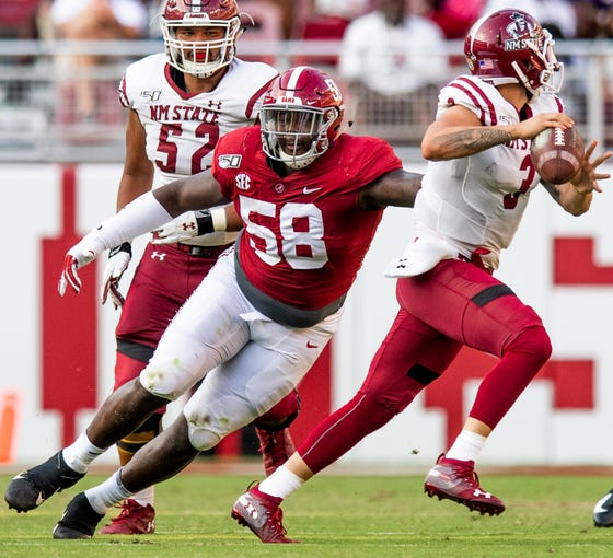 Alabama defensive lineman Christian Barmore (58) pressures New Mexico State quarterback Matt Romero (3) at Bryant-Denny Stadium in Tuscaloosa, Ala., on Saturday September 7, 2019.