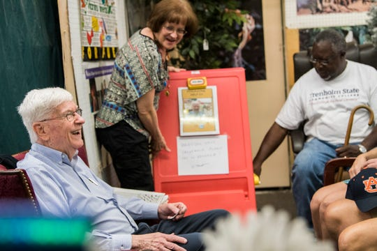 Jim Pruett talks with fellow booth owners at Eastbrook Antique Mall in Montgomery, Ala., on Monday, Sept. 9, 2019.
