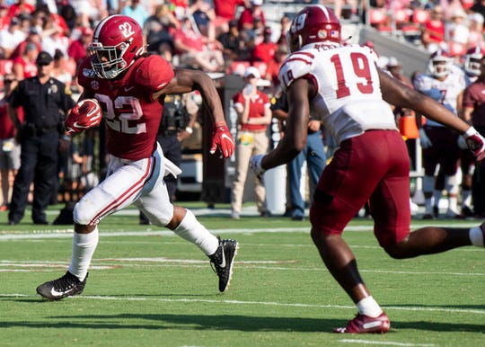 Alabama running back Najee Harris (22) carries for a touchdown against New Mexico State at Bryant-Denny Stadium in Tuscaloosa, Ala., on Saturday September 7, 2019.