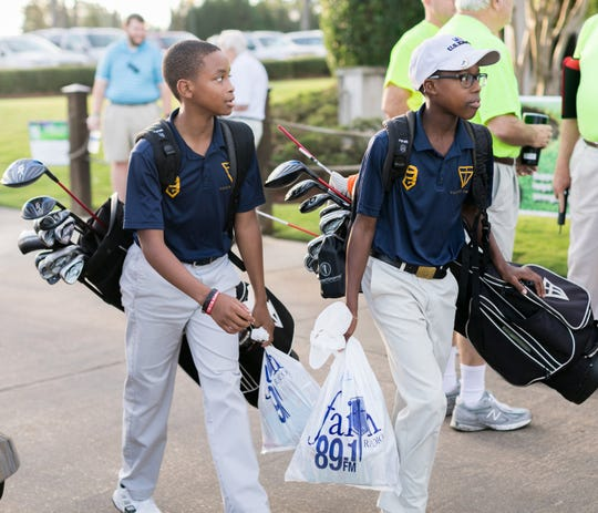 Golfers from Valiant Cross Academy prepare to take part in the 2018 Faith Radio Golf Tournament held at Wynlakes Golf and Country Club. This year's event is set for Sept. 17.