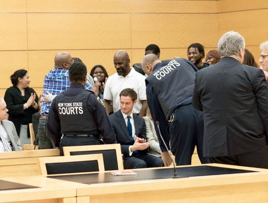 Ensler clapping in court after the judge vacated Andre Hackett's sentence.