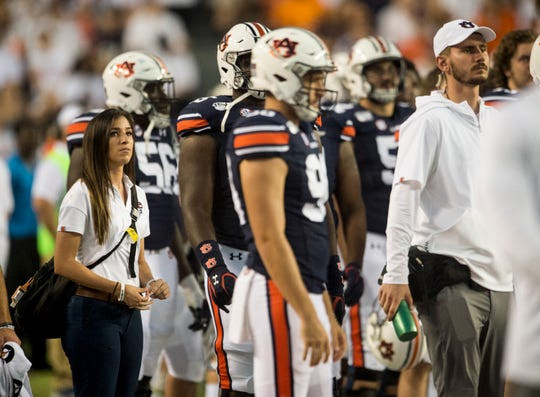 Lauren Silvio, Auburn's director of sports nutrition, watches the Tulane game from the sideline at Jordan-Hare Stadium in Auburn, Ala., on Saturday, Sept. 7, 2019. Auburn defeated Tulane 24-6.