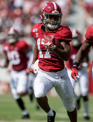 Alabama wide receiver Jaylen Waddle (17) returns a kick against New Mexico State at Bryant-Denny Stadium in Tuscaloosa, Ala., on Saturday September 7, 2019.