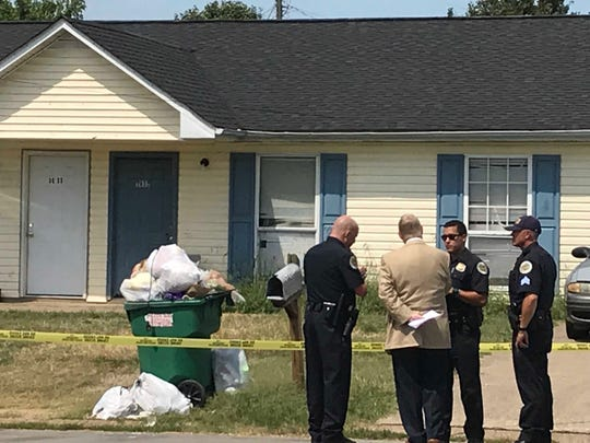 Police officials at a home on Village Trail in Nashville after a 3-year-old boy was shot on Monday.