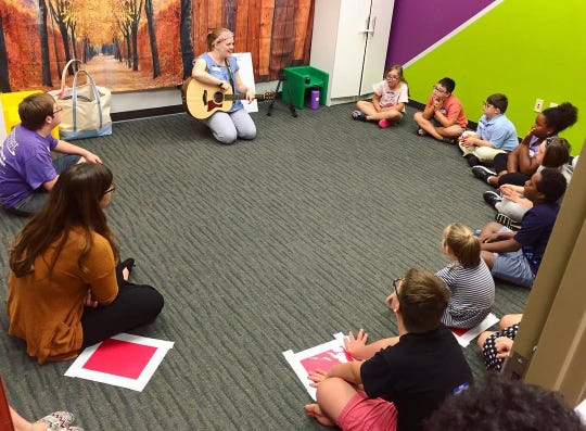 A music class is held for children at GiGi's Playhouse Nashville. Most of the classes are organized and run by volunteers, some through partnerships with area colleges and universities.