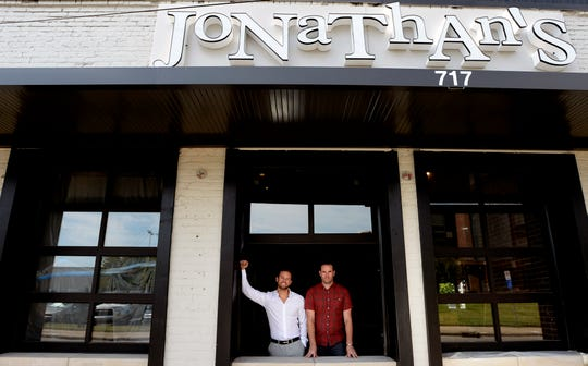 Mason and Curt Revelette pose at their new Jonathan's Grille Sports Bar in Germantown on Monday, Sept. 9, 2019, in Nashville, Tenn.