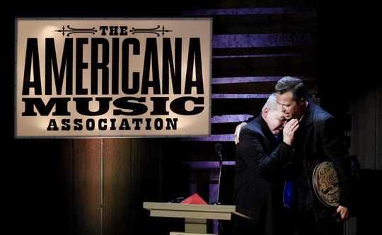 John Prine, left, and Jason Isbell hug after Prine presented Isbell with album of the year honors during the 15th annual Americana Honors & Awards show at the Ryman Auditorium on Sept. 21, 2016.