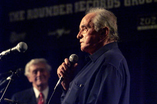 Country music legend Johnny Cash recites a poem about the flag after receiving the Spirit of Americana Free Speech Award from the American Music Association and the First Amendment Center during the Americana Honors & Awards show at the downtown Hilton on Sept. 13, 2002.