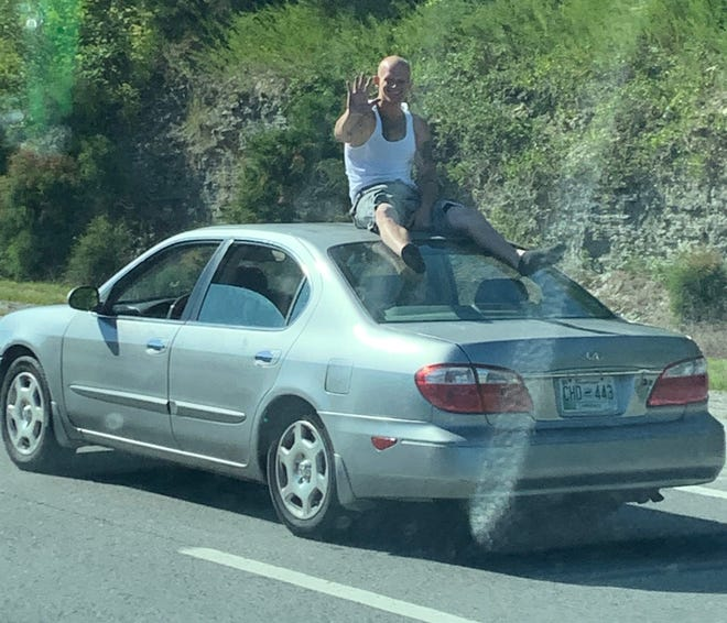 Ronnie Sellars riding on top of a car on Interstate 40 that included Wilson and Davidson counties, according to reports.