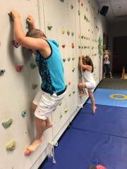 Children participate in rock climbing through GiGi's Playhouse Nashville.