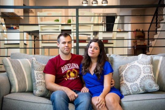 Johnathan Simpson and Maria Gutierrez pose for a photo in their home Monday, Sept. 9, 2019, in Nashville, Tenn. The couple shares a duplex with a short-term rental home in East Nashville.