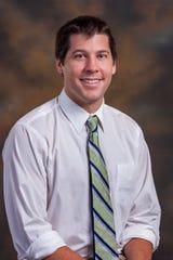 Dr. Brendan Divis