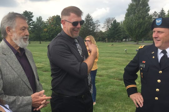 From left, Newark's Russ Ault, who found the Purple Heart in an area pawn shop and began a quest to reunite it with its owner, Eric Armbrust, grandson of Joseph, who was located a couple of weeks ago, and Col. Mark Raaker, who officially returned the medal to its rightful owner.