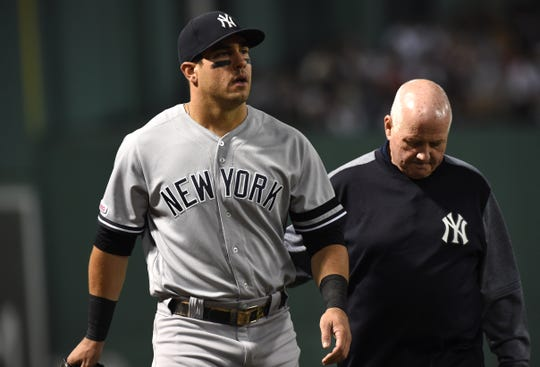 Sep 8, 2019; Boston, MA, USA; New York Yankees left fielder Mike Tauchman (39) walks off the field after an apparent injury during the fourth inning against the Boston Red Sox at Fenway Park. Mandatory Credit: Bob DeChiara-USA TODAY Sports