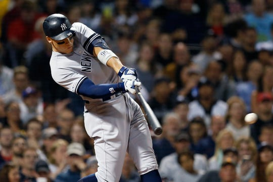 New York Yankees' Aaron Judge hits an RBI single during the third inning of a baseball game against the Boston Red Sox in Boston, Sunday, Sept. 8, 2019. (AP Photo/Michael Dwyer)