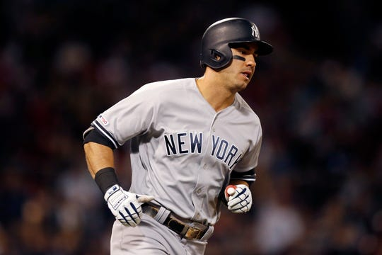New York Yankees' Mike Tauchman rounds first base on nis two-run home run during the fourth inning of a baseball game against the Boston Red Sox in Boston, Sunday, Sept. 8, 2019. (AP Photo/Michael Dwyer)
