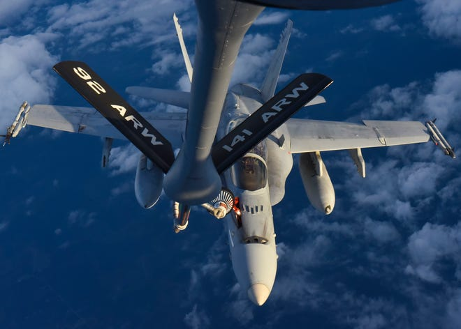 A KC-135 Stratotanker from Fairchild Air Force Base, Wash., refuels a Marine Corps F/A-18C Hornet from Marine Aircraft Group 31 while flying over Georgia, Aug. 27, 2019. The refueling shows the strength of the joint partnership between the two branches, which enables Rapid Global Mobility for the United States.