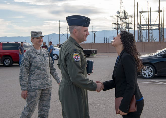 Col. Joseph Campo, 49th Wing commander, and Chief Master Sgt. Sarah Esparza, 49th Wing command chief, greet Xochitl Torres Small, New Mexico 2nd district congresswoman, Sept. 6, 2019, outside Holloman Air Force Base, N.M. Torres Small conducted an immersion tour of Holloman AFB and mission partners.