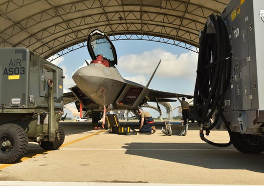 U.S. Air Force Airmen prepare an F-22 Raptor for takeoff at Joint Base Langley-Eustis, Virginia, September 3, 2019. The F-22 was being moved to Rickenbacker Air National Guard Base, Ohio, in preparation for Hurricane Dorian.