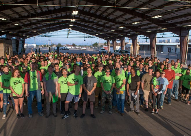 Volunteers from Holloman Air Force Base, N.M. and the local Otero County community pose a photo, Sept. 6, 2019, at the Otero County Fairgrounds in Alamogordo, N.M. Day of Caring volunteers performed various tasks, such as home repairs and yard work, at pre-determined job sites for individuals who are either unable to accomplish the tasks themselves or do not the resources to do so.