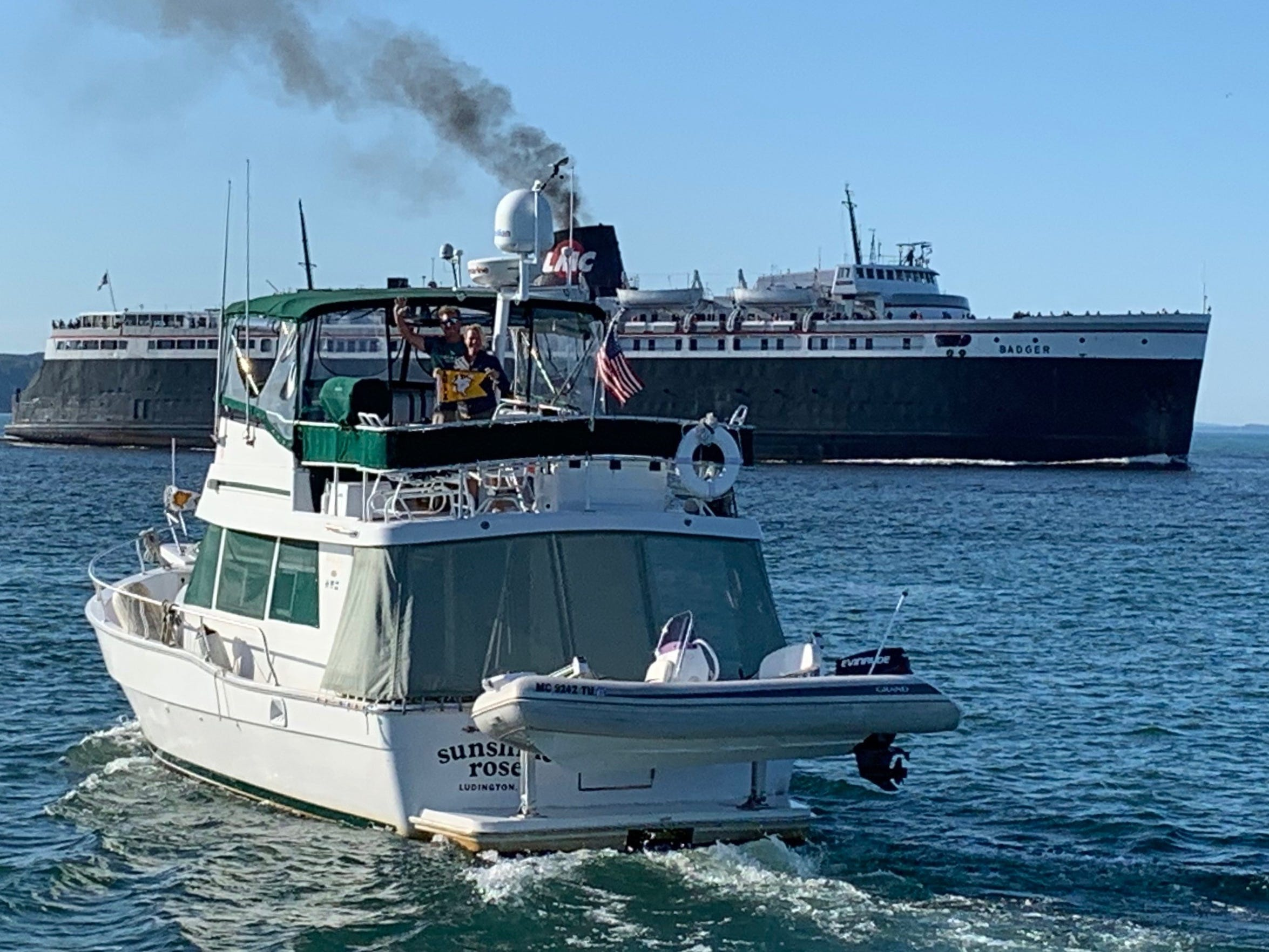 The Sunshine Rose heads into Ludington, completing a 5,600 mile Great Loop journey while the SS Badger makes its way to Manitowoc, Wisc.