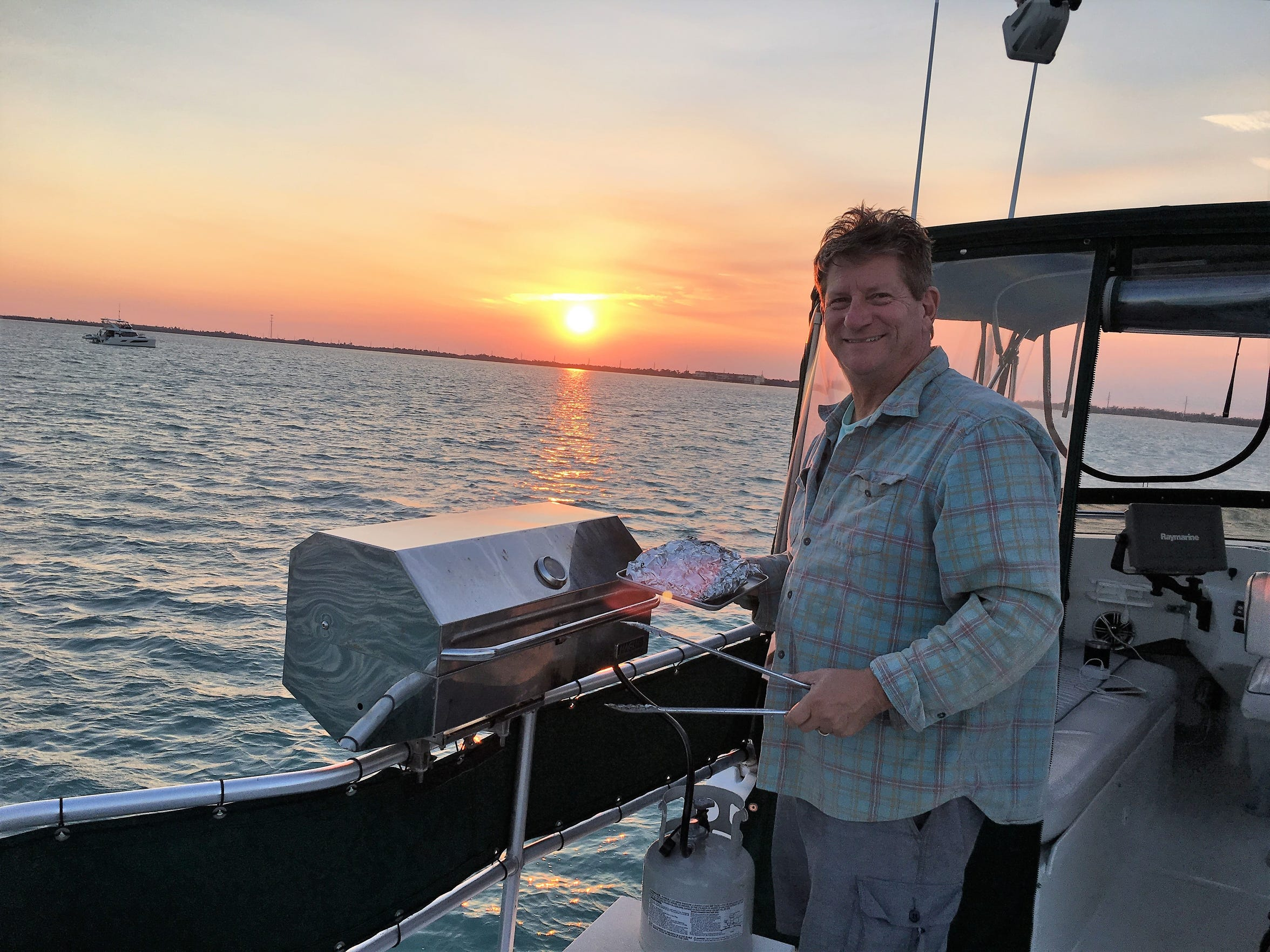 Dave Baker grills on his boat in the Florida Keys during the America's Great Loop journey he and wife Rose took over the course of 11 months.