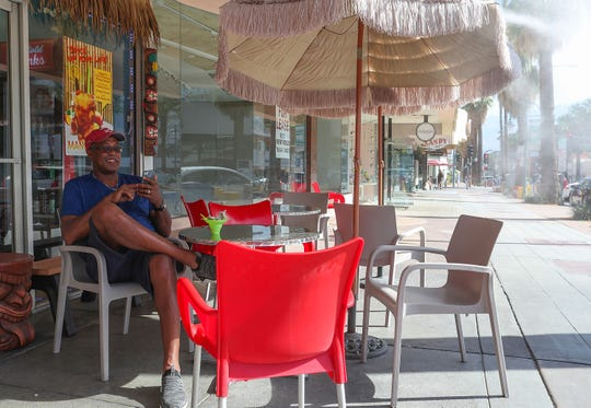 Rick Marsh of Chicago enjoys the cooler temperatures while having some ice cream in downtown Palm Springs on Sept. 9, 2019.