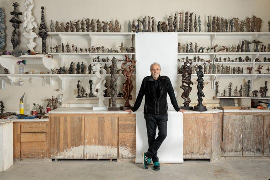 Herb Alpert and a collection of his totem pole sculptures.