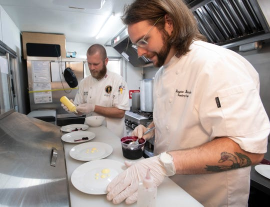 From left, Joshua Spiess, owner of the Arepas food truck, and Blayne Barsuhn, Pensacola Country Club sous chef, practice their plating skills Monday. The team will compete in the World Food Championships next month in Dallas.