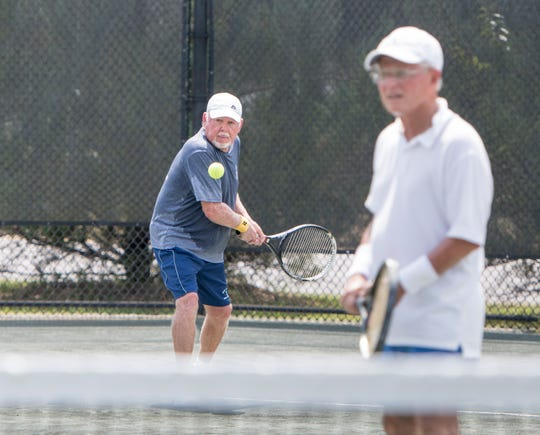 Ric Pounders, left, and Ray Peoples play tennis during the extremely hot weather at the Roger Scott Tennis Center in Pensacola on Monday, Sept. 9, 2011.