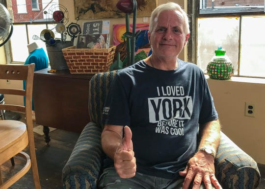 """Tony Kastelic sports his """"I loved York before it was cool"""" shirt at i-ron-ic Coffee Shop and Art Boutique in York. After losing his wife to an overdose, Kastelic's life was a roller coaster of ups and downs. With a few positive times in recovery homes and a lot of negative experiences in relapsing, Kastelic attempted to end his life. When he awoke in the hospital, an empathetic doctor saw something in him that wanted to cling onto life. That doctor ultimately got him help in York, and that's why Kastelic now says York """"fixed"""" him. These days, he stays active in his recovery by helping others in recovery homes and groups. Read the full story here: bit.ly/2p5178f"""