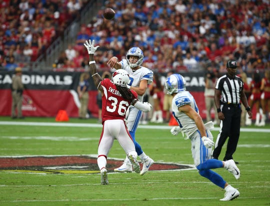 Cardinals safety D.J. Swearinger (36) pressures Lions quarterback Matthew Stafford (9) during the second half of a game Sept. 8 at State Farm Stadium.