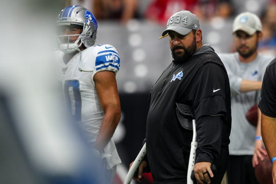 Detroit Lions head coach Matt Patricia watches his team warm up before the Arizona Cardinals vs. Detroit Lions game Sunday, September 8, 2019 at State Farm Stadium.