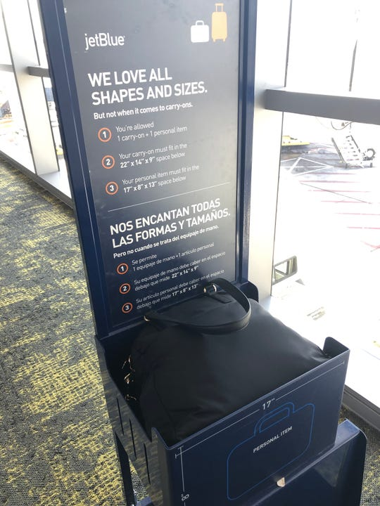 """Sun Country didn't have its own luggage measuring box so I measured my personal item in JetBlue's whose """"personal item"""" allowance is a bit smaller than Sun Country."""