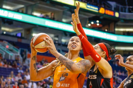 Phoenix Mercury center Brittney Griner goes up for a layup against pressure from the Las Vegas Aces in the first half on Sep. 8, 2019 in Phoenix, Ariz.
