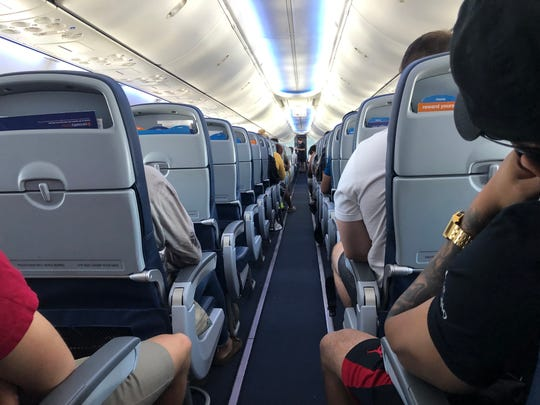 View down the aisle of a Sun Country aircraft.